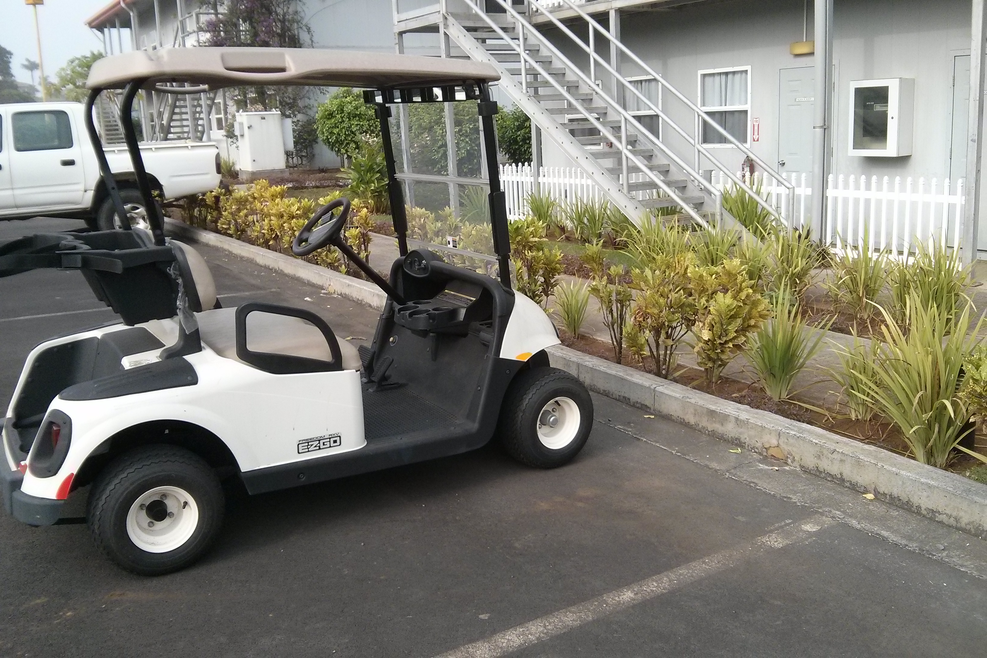 "The little golf buggy ""Ezzy"" to transport me around the compound."